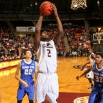 The University of Louisiana at Monroe's DeMondre Harvey goes up for a layup in front of Georgia State defenders R.J. Hunter (22) and Markus Krider (33) on Thursday in ULM's Fant-Ewing Coliseum.