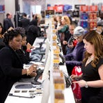 In this Oct. 28, 2014 file photo, shoppers check out at the Century 21 Department Store in Philadelphia. The Federal Reserve releases consumer credit data for January on Friday, March 6, 2015.