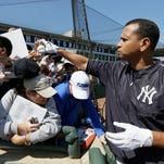 New York Yankees third baseman Alex Rodriguez signs autographs before a spring training exhibition baseball game against the Houston Astros on Sunday in Kissimmee, Fla.