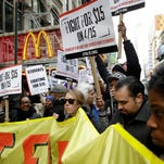 People participate in rally in front of a McDonalds in New York on Tuesday.