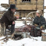 "This image released by Roadside Attractions shows Tommy Lee Jones, left, and Hilary Swank in a scene from ""The Homesman."" (AP Photo/Roadside Attractions, Dawn Jones)"