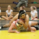 Virgin Valley's Cache Burnside tries to prevent his opponent from escaping.