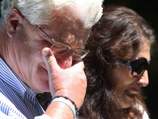 After speaking with U.S. President Barack Obama by phone, John and Diane Foley talk to reporters, Wednesday, Aug. 20, 2014, outside their home in Rochester, N.H.  Their son James Foley was abducted in November 2012 while covering the Syrian conflict. Islamic militants posted a video showing his murder on Tuesday and said they killed him because the U.S. had launched airstrikes in northern Iraq.
