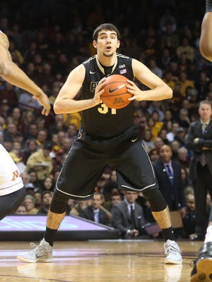 Purdue's Dakota Mathias passes the ball in the first half of an NCAA college basketball game against Minnesota, Saturday, Feb. 7, 2015, in Minneapolis. (AP Photo/Jim Mone)