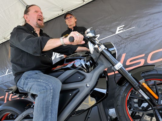 Bill O'Brien with 98.5 The Peak radio station, reacts while participating in the Harley-Davidson Livewire simulation during the company's open house on Thursday, Sept. 24, 2015.  Jason Plotkin - York Daily Record/Sunday News