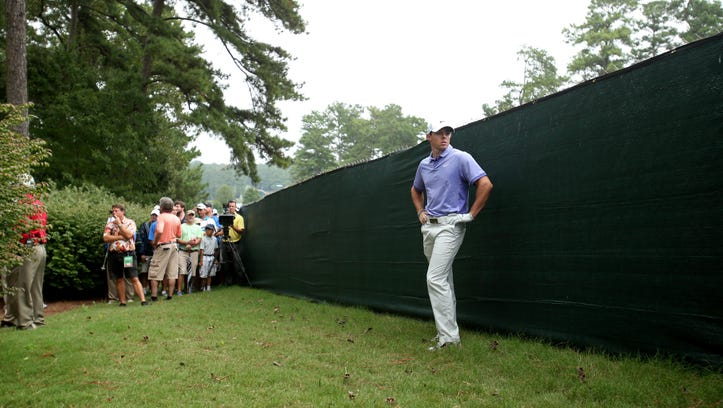 Sep 14, 2014; Atlanta, GA, USA; Rory McIlroy prepares to hit his second shot in the rough on the ninth hole during the final round of the Tour Championship at East Lake Golf Club. Mandatory Credit: Jason Getz-USA TODAY Sports