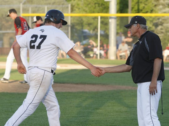 Ankeny Centennial coach Mark Hey congratulates Cameron Cowan as he rounds the bases after hitting a two-run homer during Friday's Class 4A substate quarterfinal against visiting Newton. The Jaguars posted a 3-0 victory and will host a substate final on Wednesday.