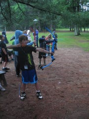 Campers practice their archery skills.