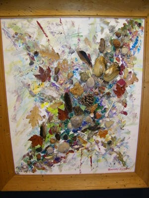 One of Rosemary Schramm's many paintings integrating items she finds in nature into three-dimensional works of art.