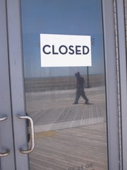"""This April 24, 2015 photo shows a """"closed"""" sign on a door of the former Revel casino on the Atlantic City, N.J. Boardwalk, one of four Atlantic City casinos to go out of business in 2014. Three New Jersey lawmakers introduced a bill on June 8, 2015 that would ask voters whether to approve two new casinos in the northern and central portions of the state. Voters would need to amend the state Constitution in a referendum to permit gambling outside Atlantic City."""