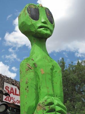 A roadside alien beckons near Ruidoso, N.M.