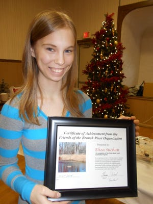 Eliza Suchan shows the certificate of achievement that was awarded to her by the Friends of the Branch River organization for completion of the Vickie Mayer Youth Leadership Program. She will attend the Wisconsin Youth Leadership Camp in Vilas County this summer.