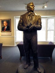 A statue of Mormonism founder Joseph Smith stands inside the visitor's center at Smith's birthplace in Sharon, Vt.