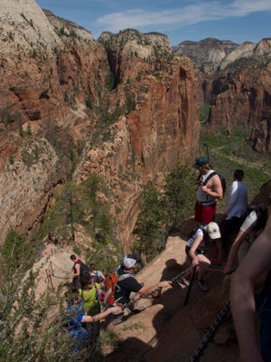Hikers enjoy the trail to the top of Angels Landing in Zion National Park Thursday, April 21, 2016. All week, entrance fees have been waived at the national parks, including Zion, to commemorate National Parks Week. Entrance fees will continue to be waived through the weekend.