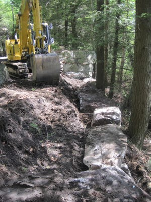 Construction is shown on the Castle Point Carriage Road, a 4.6-mile scenic trail to from Lake Minnewaska to Lake Awosting.