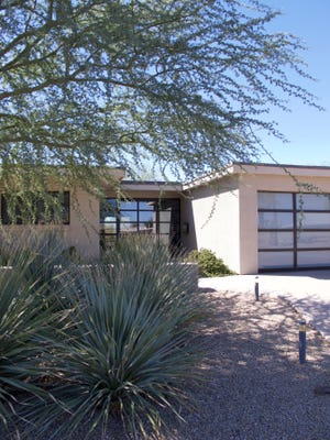 When brothers Justin and Brandon Nee bought their home in Scottsdale's Hy-View neighborhood, it was so dilapidated that all the windows were cracked or boarded up. The extensive renovation included enclosing the original carport to create a garage and installing custom windows and doors to update the house while maintaining its mid-century appeal.