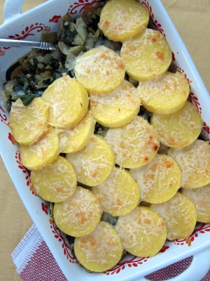 Cheesy Polenta and Greens Casserole is a hearty vegetarian casserole.