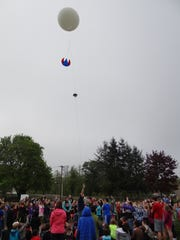 Raising a weather balloon kicked off the lesson on weather as Laurie Taitano's fifth-grade class tutored younger Turner Elementary School students during a Science Day project on May 3.