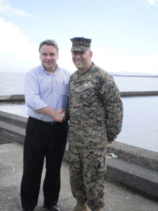 Rep. Chris Smith and Col. Eric Mellinger meet in Philippines