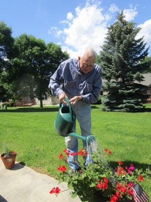 Father Edward Sippel will celebrate 70 years in the priesthood this year as he continues to garden and serve the community.