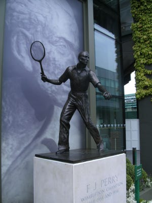 A life-sized statue of Fred Perry, famed British tennis champion, welcomes visitors to Wimbledon.