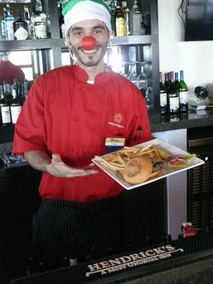 Chef Angel Robles of JJ's Bar & Grille in West Melbourne gets into the holiday spirit by donning a Rudolph nose.