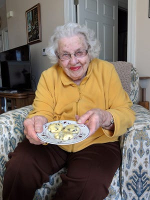 Viola Becker holds a plate of Orange Chocolate Chippers, a Christmas favorite in her family since 1956.