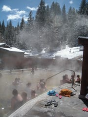 Bathers enjoy a dip in the hot springs pool at Grover Hot Springs State Park.