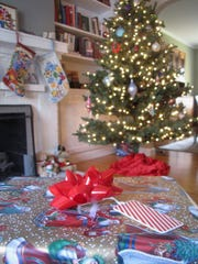 A wrapped present and Christmas tree.