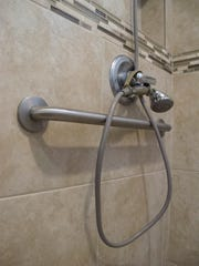 The shower in the master bath has two shower heads: