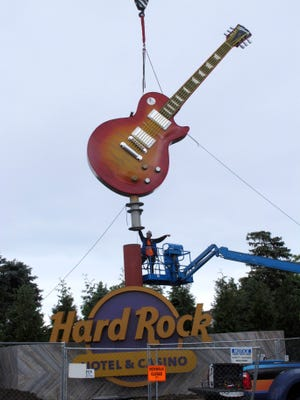 A large guitar replica is lifted into place as a street marker on Thursday, June 21, 2018, a few blocks away from where the Hard Rock Casino will open in Atlantic City, N.J., on June 28. The sign was installed on the same day that a different casino also opening on June 28, the Ocean Resort Casino, was granted a casino license by New Jersey gambling regulators.