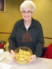 Sandy Nearhood, of Clyde, with her Corn Chip Salad. She got the recipe from a Mennonite cookbook while visiting friends in Millersburg. It includes ingredients like corn chips, lettuce, bacon and cheese.