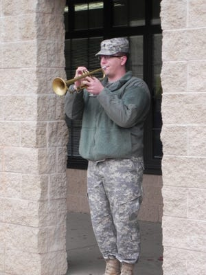 Alexander Witt played Taps on the trumpet at Jefferson Elementary on Veterans Day. He is serving with the 132nd Army Band of Madison, Wis.