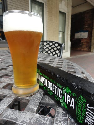 Stone Brewing Unapologetic IPA's hop bitterness is followed by a citrus and tropical fruit taste.