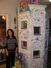 Castle of Dreams owner Sande Gottron in the Mermaid Bathroom. Gottron and her 9-year-old granddaughter, Abby Rogers, decorated this sandcastle that encloses the room's shower.
