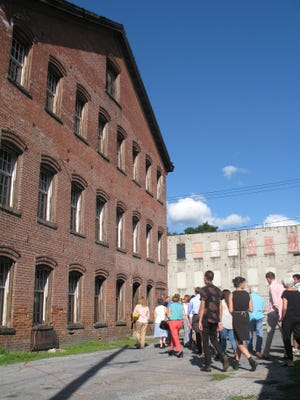 Visitors look inside the old underwear factory in the City of Poughkeepsie, as Hudson River Housing says it's getting funds together for a $5 million conversion to housing and work space.