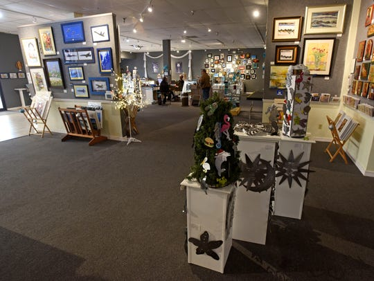 Shoppers look at art Dec. 10, 2017, at Blue Morning