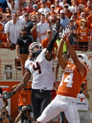 Oklahoma State defensive back A.J. Green (4) goes up
