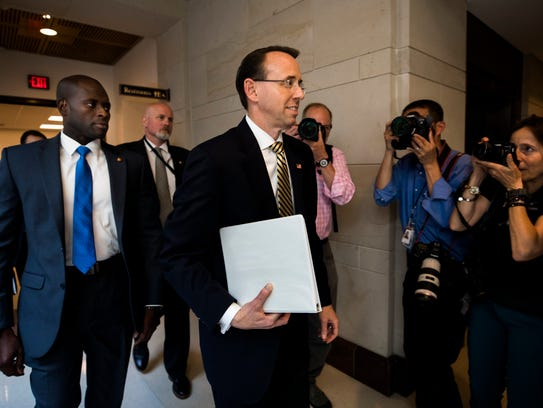 Deputy Attorney General Rod Rosenstein walks to a briefing