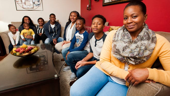 Ericka Davis, right, a single mom, is shown with her children and the children of her sisters, from left,  Alayla, Emmanuel, Atyreya, Zakedra, Rickem, Alexia, Marshon and Jalonie, that she is raising at her home in Montgomery, Ala. on Tuesday December 22, 2015.