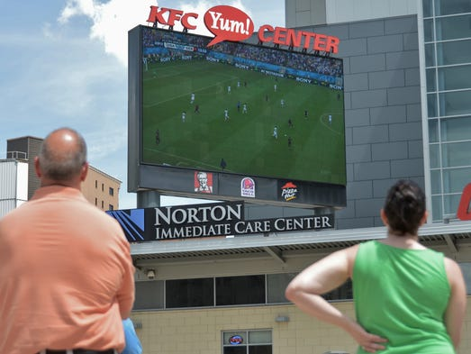 Soccer fans congregated on the Norton Healthcare Plaza out front of the KFC YUM! Center to watch USA vs Germany in the 2014 FIFA World Cup on the large outdoor screen Thursday afternoon. June 26, 2014.