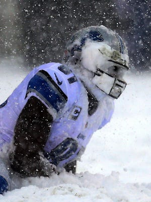 Detroit Lions' Calvin Johnson has a face full of snow after a catch against the Philadelphia Eagles on December 8, 2013 at Lincoln Financial Field in Philadelphia.