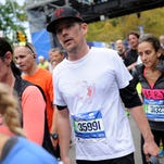 Alicia Keys, center, runs with other participants during the TCS New York City Marathon on Sunday.