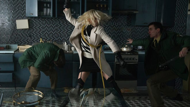 Charlize Theron wasn't dressed for a fight in this break-in scene from 'Atomic Blonde.' But she recovered well.