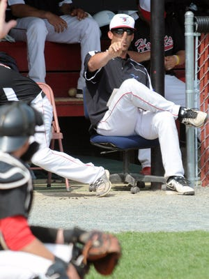 Delaware State manager J.P. Blandin calls pitches from the dugout in a 2013 game.