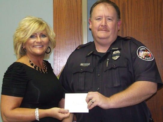Officer Ricky Smith, left, September Employee of the