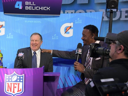 Bill Belichick reacts as he is interviewed by former