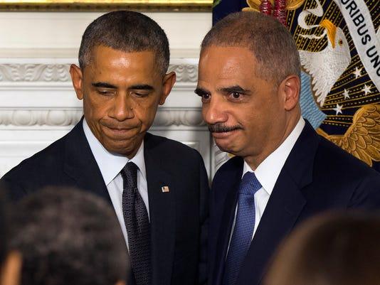 Obama Holder Resignat_Desk.jpg