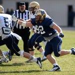 MSU's Nate Bignell pursues quarterback Dakota Prukup during the last April's Triangle Classic at Memorial Stadium.