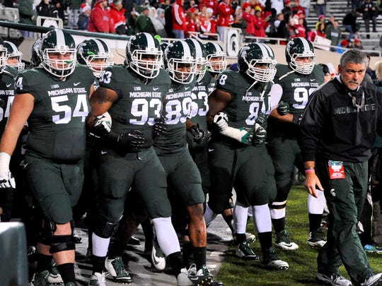 MSU football takes the field for pre-game warmups with strength and conditioning coach Ken Mannie bfore taking on Nebraska Saturday 10/4/2014. (Rod Sanford | Lansing State Journal)